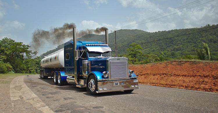 blue semi truck driving